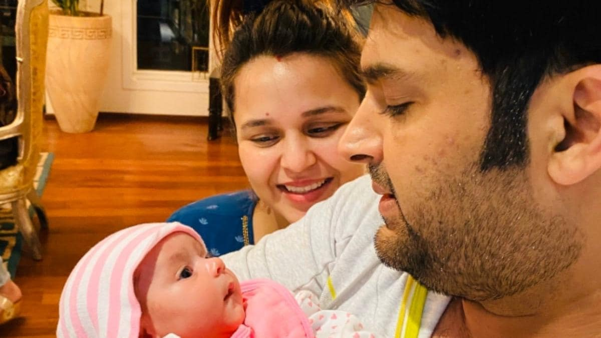Current image of Kapil Sharma: Photo with wife and daughter