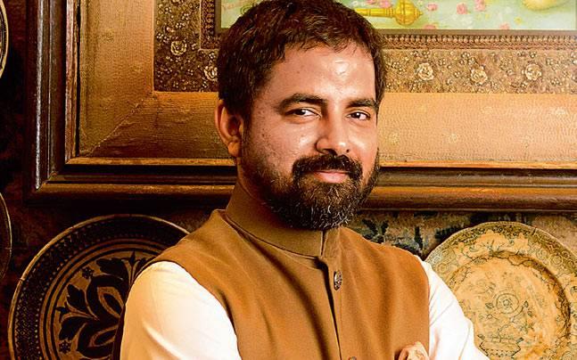 sabyasachi-mukherjee side pose image with smile