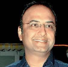 Anand Mahindra's brother Charu Sharma
